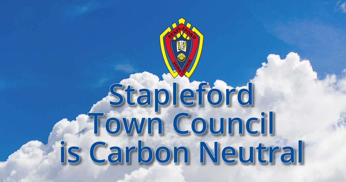 Picture of white clouds and blue sky with Stapleford Town Council Logo and message saying Stapleford Town Council is Carbon Neutral